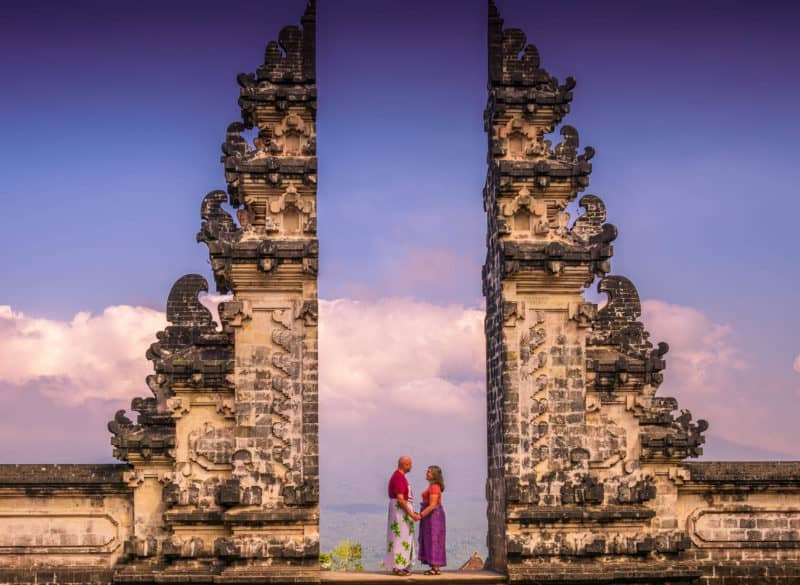 Couple posing at the gate of Pura Lempuyang, one of Bali's 9 directional temples