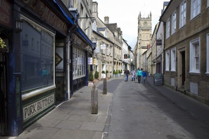 Street in Cirencester with church spire in background