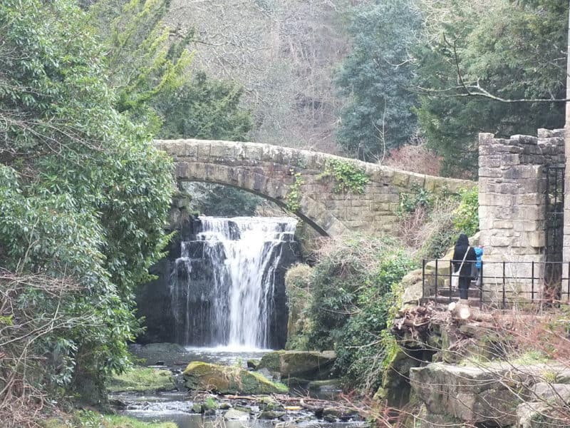 Stone bridge and waterfall at Jesmond Dene Mill