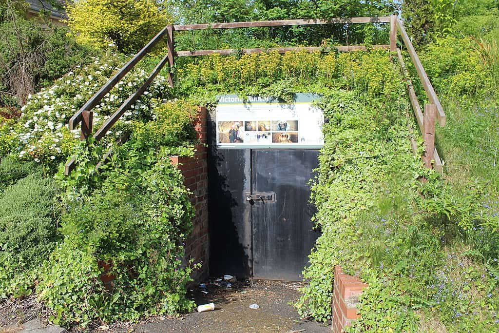 Doorway recessed into hillside with sign overhead that says Victoria Tunnel