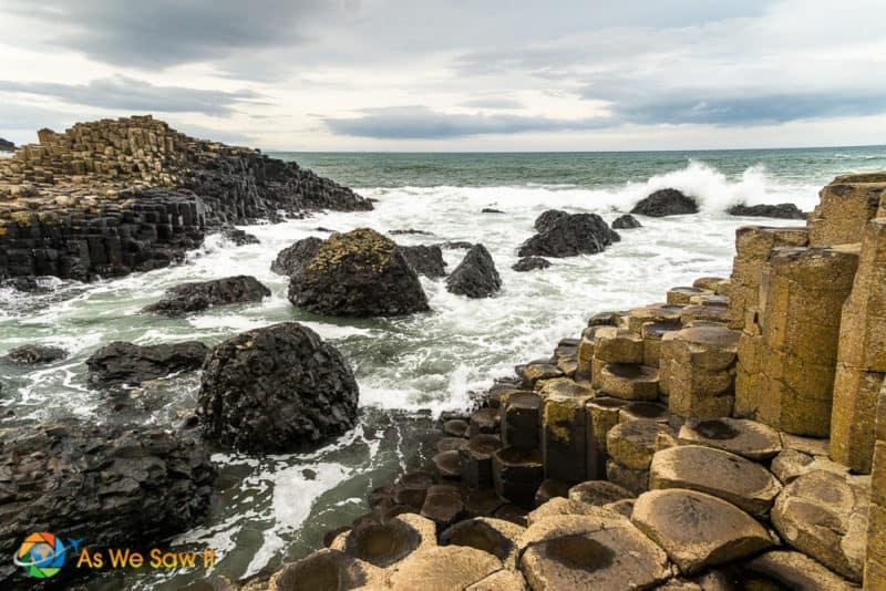 waves crashing against hexagonal rocks at Giant's Causeway