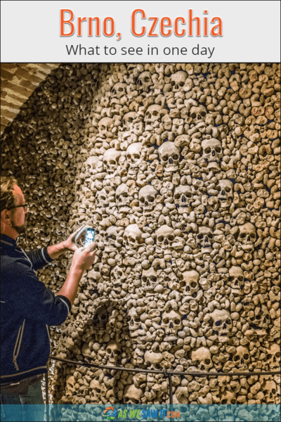 Man photographs crypt in Brno. Text overlay says Brno, Czechia What to see in one day.