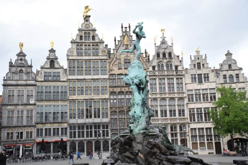 ornate fountain and houses in Antwerp Belgium