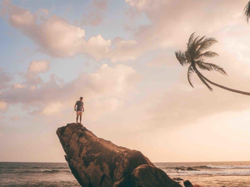 Man standing on Wijaya rock