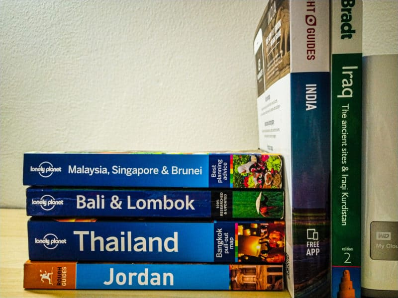 Our collection of guidebooks on our office shelf.