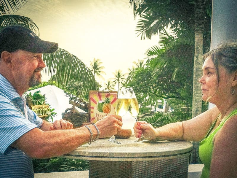 Couple toasting with champagne. Avoiding alcohol is one of the best tips to avoid jet lag