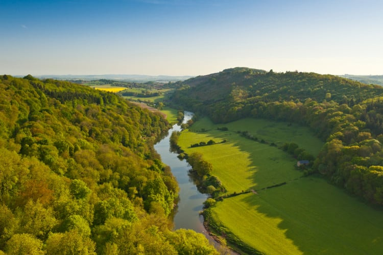 green Wye valley  with a river running through the center in wales