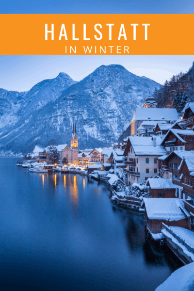 photo of hallstatt in winter with reflection of the city lights in the lake