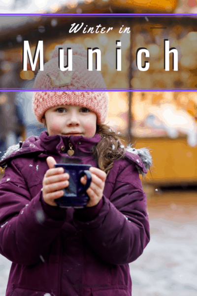 photo of little girl bundled in purple jacket with hot chocolate text says munich in winter