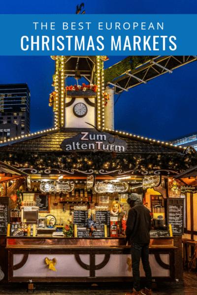 christmas market vendor stall text says the best european christmas markets