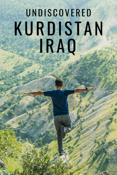 Man balancing on narrow outcrop. Text overlay says Undiscovered Kurdistan Iraq