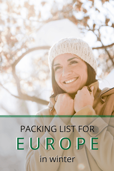 woman bundled with hands closing her collar text says packing list for europe in winter
