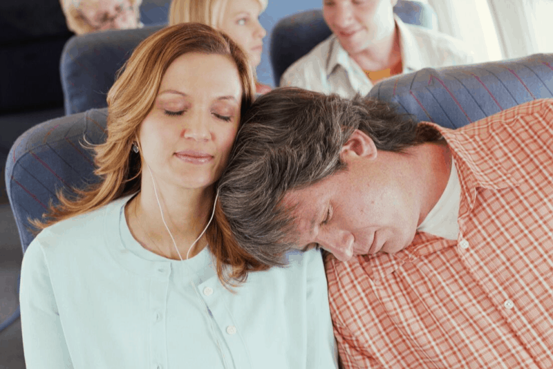 couple sleeping on the plane