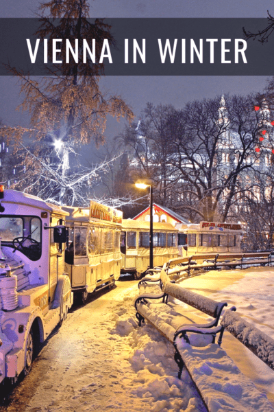 snowy night with train ride at vienna christmas market text says vienna in winter