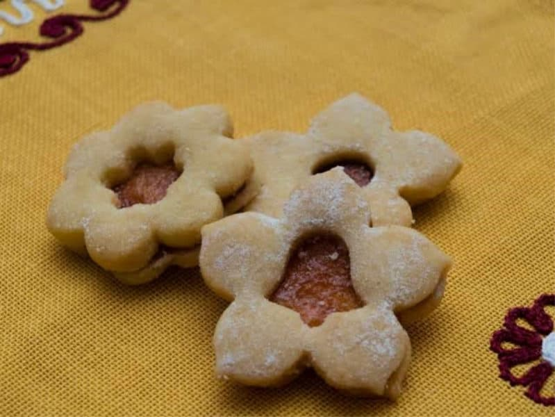 3 Vanocni Cukrovi, filled Czech christmas cookies. Assorted shapes cut in the top, circle, bell and star.