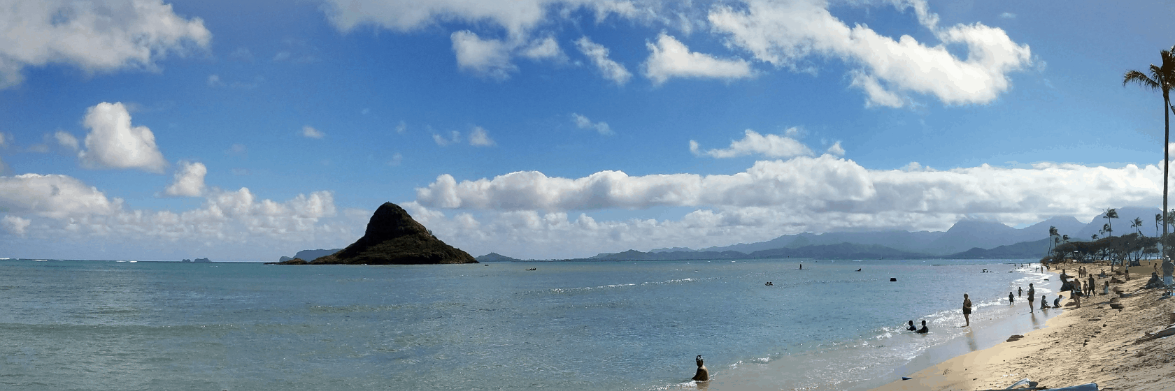 oahu beach and mountain with water in foreground