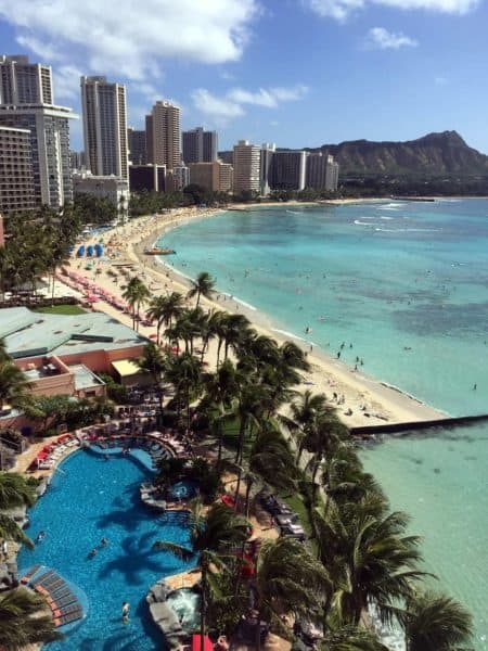 Waikiki beach lined with highrise hotels and beachfront