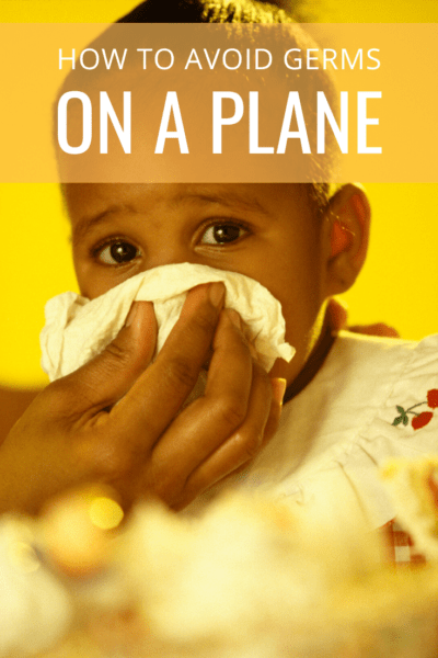 Mom wiping child's nose text says how to avoid germs on a plane