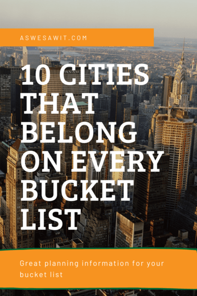 aerial view of new york city text says aswesawit.com 10 cities that belong on every bucket list