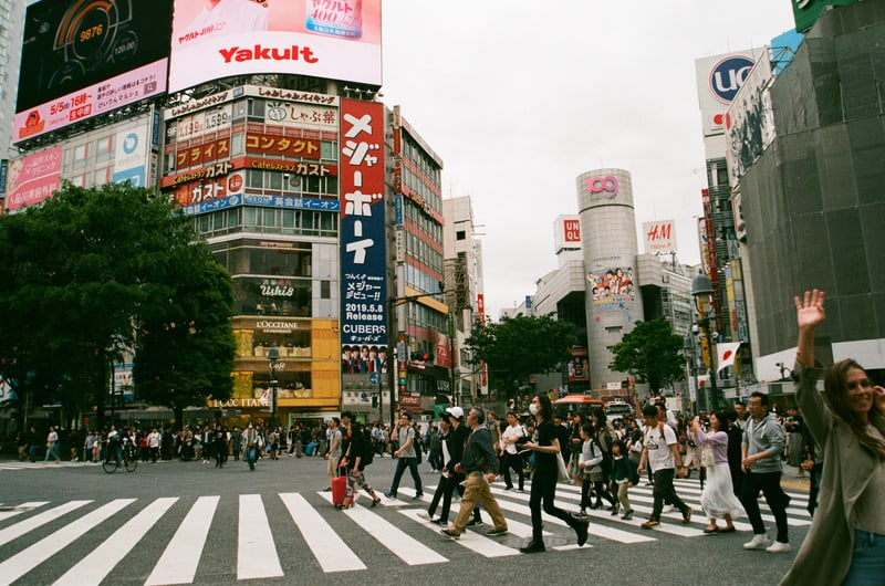 People crossing the street near Shibuya Station in Tokyo.