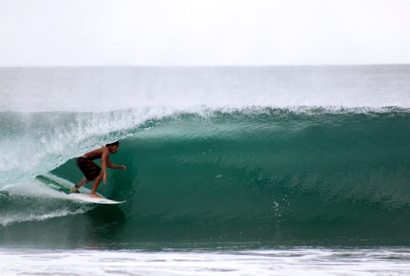 surfing a pipeline wave at a mexican riviera cruise port