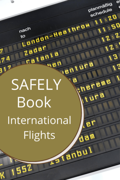 departure flights board at airport text says safely book international flights