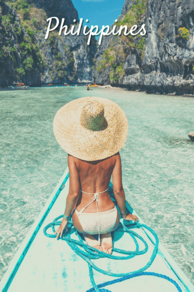 woman with large hat and bathing suit on a paddleboard text says philippines