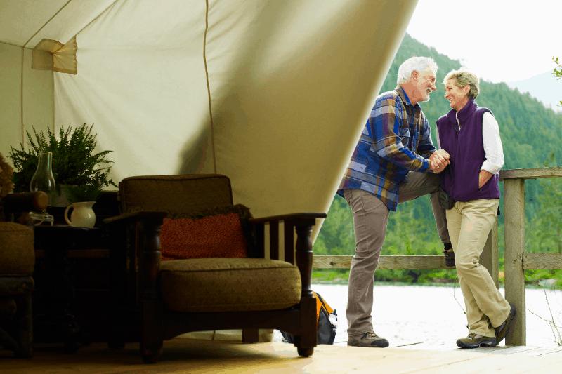 Luxury safari tent with couple outside