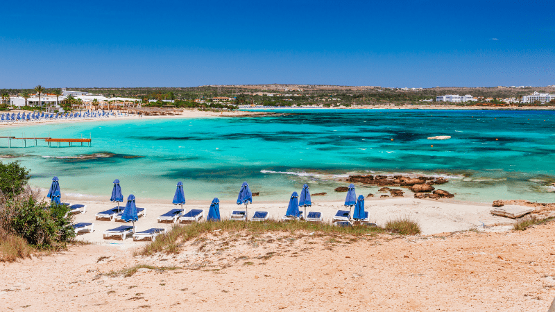 Umbrellas and beach chairs on Ayia Napa beach in Cyprus