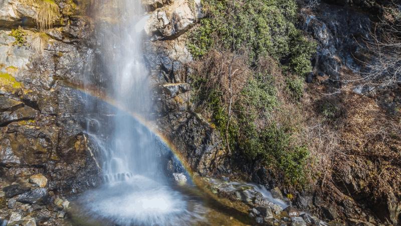 rainbow at the base of Caledonia Waterfalls