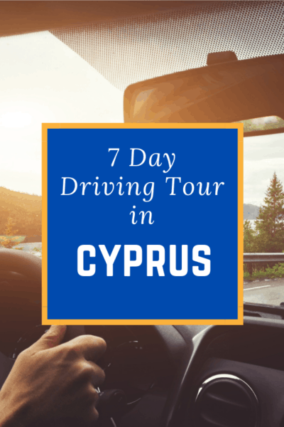 inside a car driving text says 7 day driving tour in cyprus