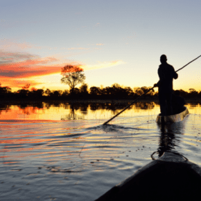 exploring Chobe river by local canoe at sunrise