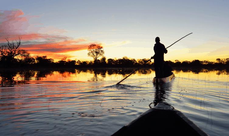 exploring Chobe river by local canoe at sunrise