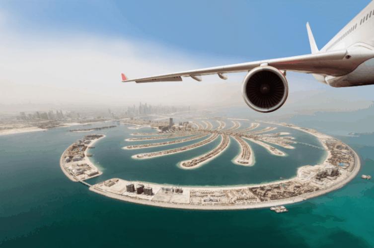 airplane wing above dubai - 1 week 7 day uae itinerary