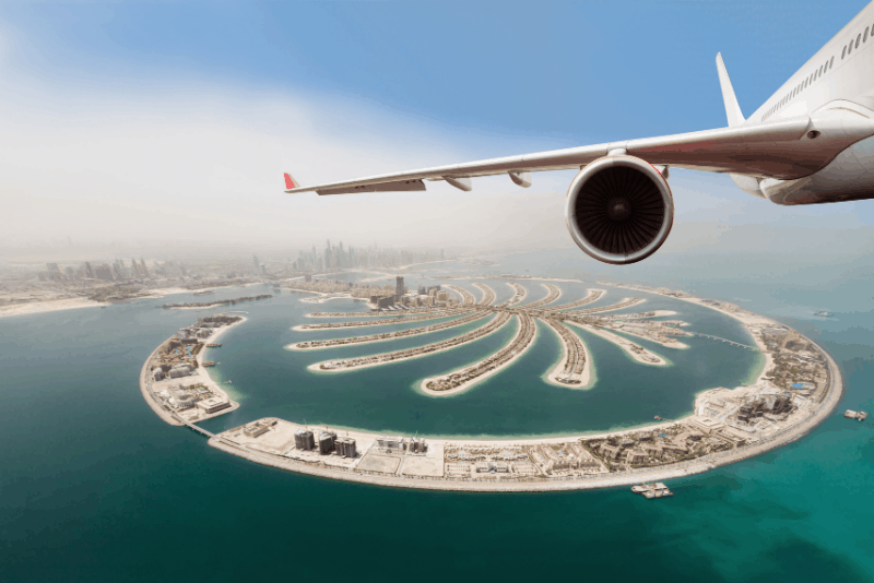 airplane wing above dubai - 1 week 7 day uae itinerary