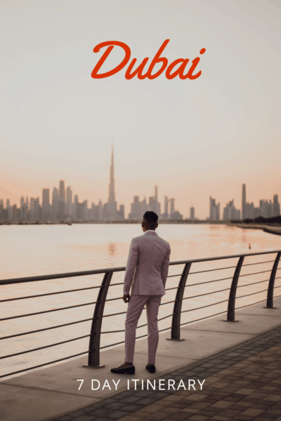 Man on walkway in Dubai. Text overlay says Dubai 7 day itinerary