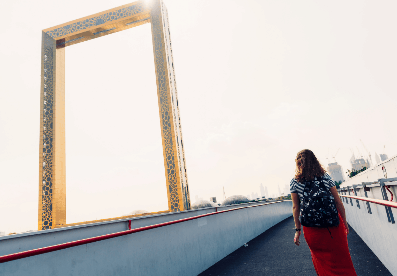 woman on walkway next to Dubai Frame, part of the 7 day UAE itinerary