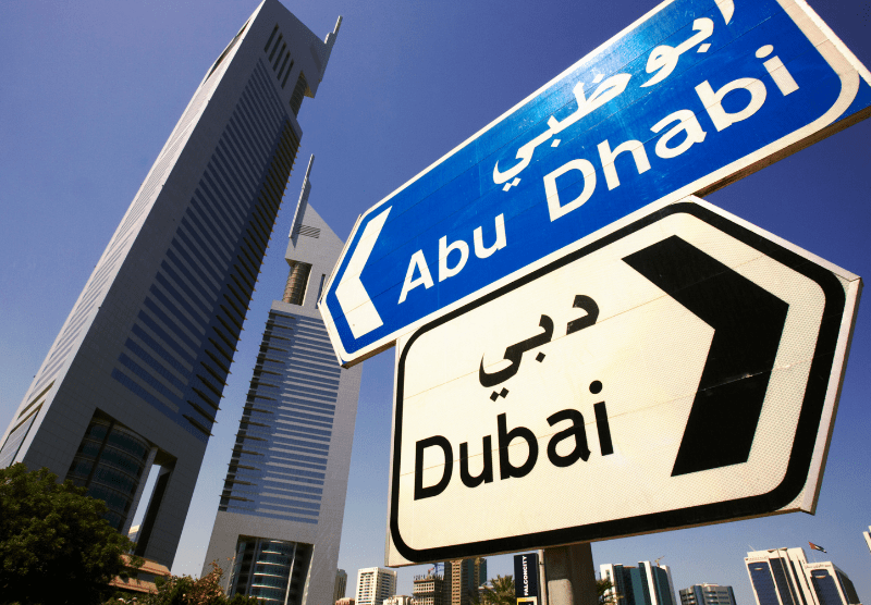 UAE street signs pointing to abu dhabi and dubai