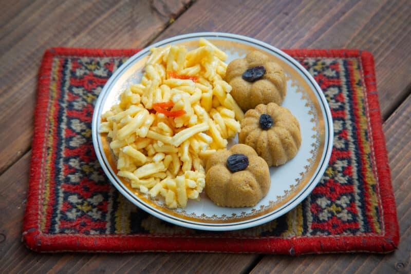 A plate of chak-chak and 3 raisin-topped zhent, traditional Kazan dishes