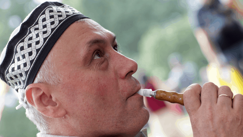 A man smoking a hookah and wearing a Tatar tubeteika. This hat makes a good souvenir of Kazan.