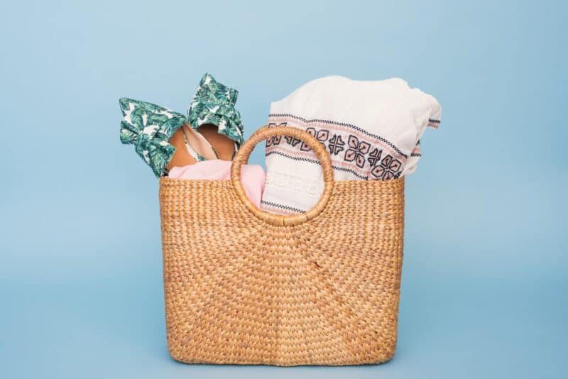 straw bag filled with things you'll want to bring on a Florida day trip