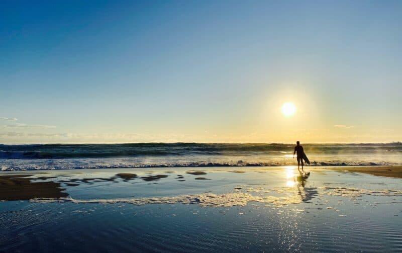 Surfer on a beach at Palm Beach