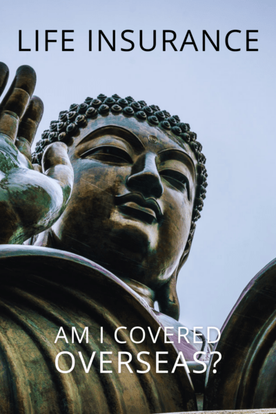 Closeup of Buddha statue with hand raised. Text overlay says Life Insurance Am I covered overseas?