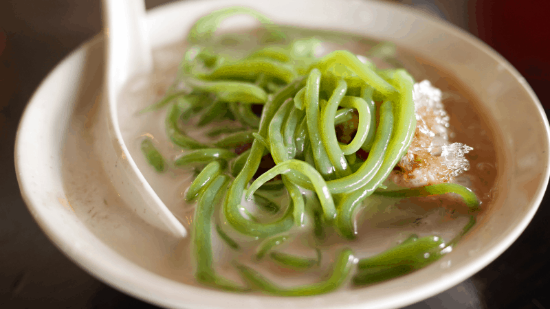 green ribbons of rice over cendol iced dessert
