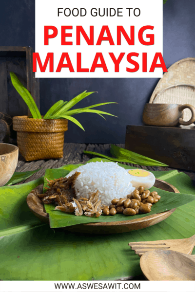 """Plate with rice, dried ikan bilis fish, peanuts and half of a hard boiled egg. Text overlay says """"Food guide to Penang Malaysia"""""""