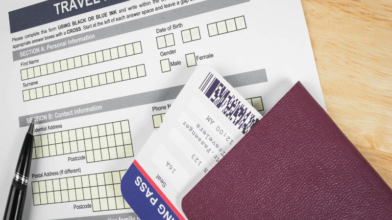 passport and boarding pass on top of an application for entry