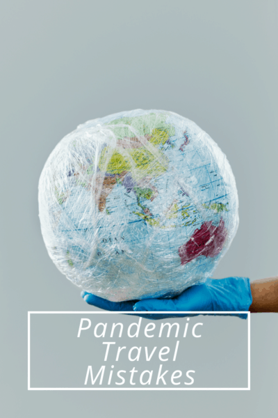 """Gloved hand holding a plastic-wrapped globe. Text overlay says """"pandemic travel mistakes"""""""