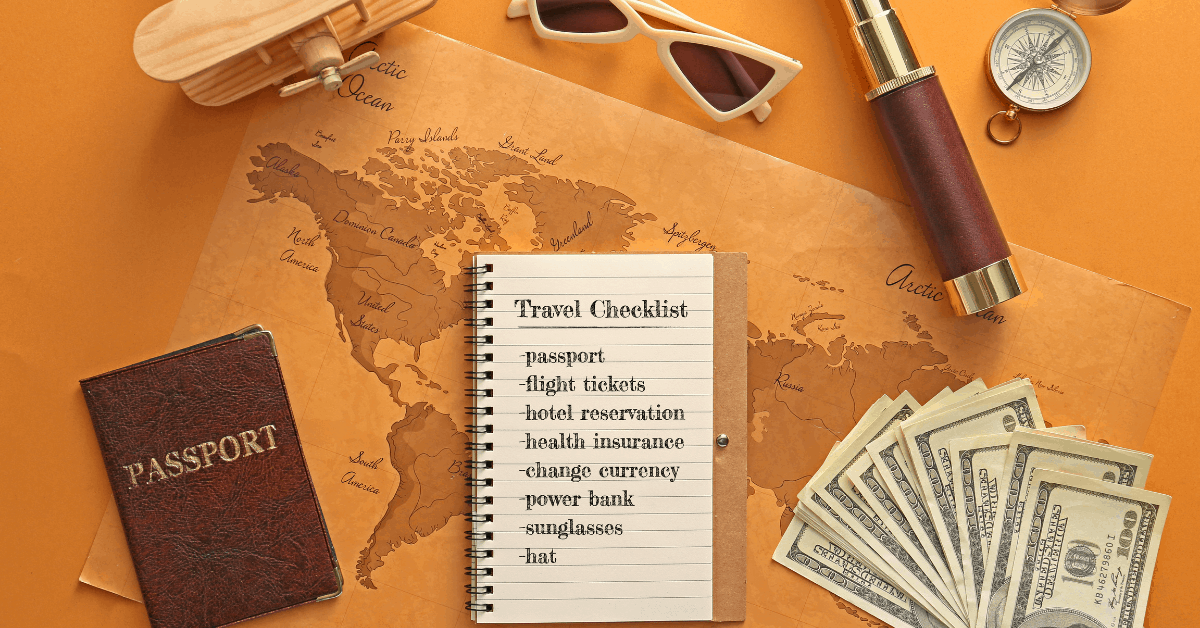 Assorted travel related items surrounding a notebook with a checklist of things to prepare before travelling abroad