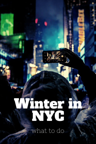 Person taking a photo of the Ball Drop at Times Square. text overlay says winter in nyc what to do