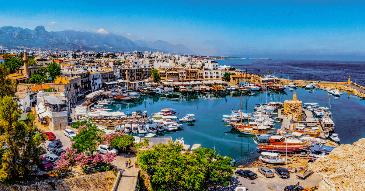 Harbor and town in Cyprus with ocean in background
